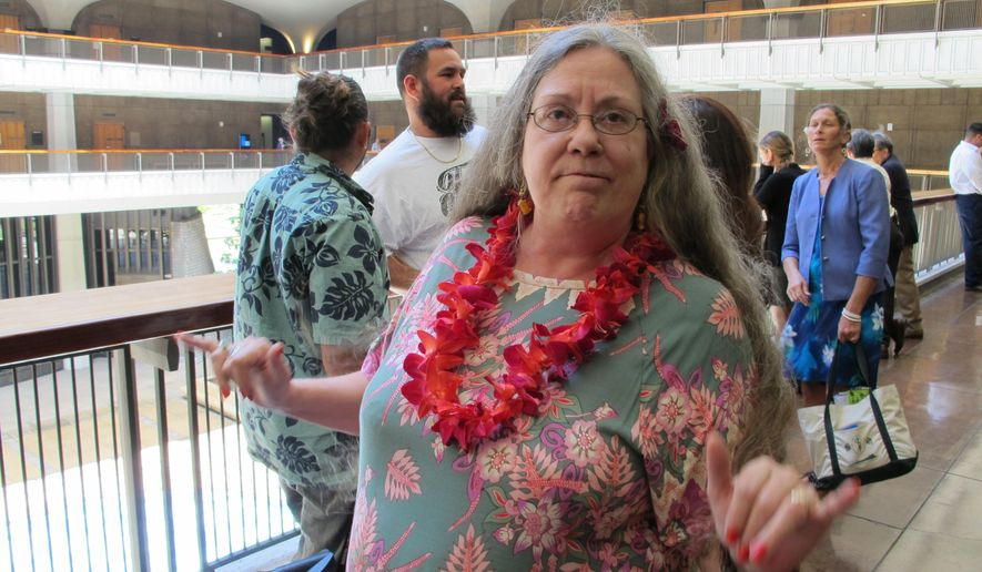 Teri Heede, 60, talks about a bill to set up medical marijuana dispensaries on Monday, May 4, 2015 in Honolulu. Medical marijuana was legalized in Hawaii nearly 15 years ago, but patients like Heede, who has multiple sclerosis, have been left to grow the drug on their own or buy it on the black market. (AP Photo/Cathy Bussewitz)