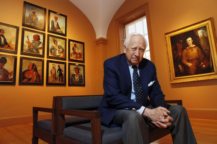 """FILE - In this May 13, 2011, file photo, historian and author David McCullough poses with art by George Catlin, one of the artists featured in his new book, """"The Greater Journey,"""" at the Catlin galleries of the Smithsonian American Art Museum in Washington. McCullough's latest work of history, """"The Wright Brothers,"""" will be released on May 5, 2015. (AP Photo/Jacquelyn Martin, File)"""