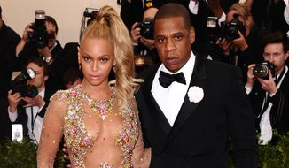 "Beyonce, left, and Jay-Z arrive at The Metropolitan Museum of Art's Costume Institute benefit gala celebrating ""China: Through the Looking Glass"" on Monday, May 4, 2015, in New York. (Photo by Charles Sykes/Invision/AP) ** FILE **"