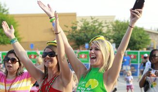Sara Macalik (left) and Whitney Beauford dance to La Freak at On The Border's Cinco de Mayo Party in Addison, Texas. (Associated Press)