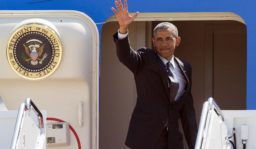 President Barack Obama waves from the doorway of Air Force One at Andrews Air Force Base, Md., Monday, May 4, 2015. Obama is flying to New York City. (AP Photo/Cliff Owen)