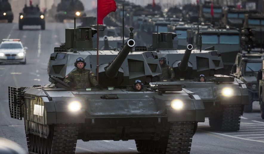 New Russian military vehicles including the new Russian T-14 Armata tank, foreground, make their way to Red Square during a rehearsal for the Victory Day military parade which will take place at Moscow's Red Square on May 9 to celebrate 70 years after the victory in WWII, in Moscow, Russia, Monday, May 4, 2015. Russia's new Armata tank has appeared in public for the first time, rumbling down a broad Moscow avenue on its way to Red Square for the Victory Day parade's final rehearsal. (AP Photo/Alexander Zemlianichenko)