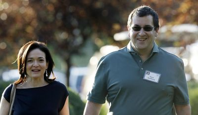 In this July 10, 2013, file photo, Sheryl Sandberg, COO of Facebook, left, and her husband David Goldberg, CEO of SurveyMonkey, walk to the morning session at the Allen & Company Sun Valley Conference in Sun Valley, Idaho. Goldberg was exercising at a gym in a Mexican resort when he collapsed before he died Friday, May 1, 2015, a person close to the family says. (AP Photo/Rick Bowmer, File)