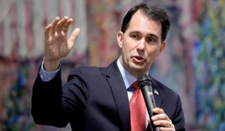 Wisconsin Gov. Scott Walker speaks Monday, May 4, 2015, at the R.E. Olds Transportation Museum in Lansing, Mich., during a lunch hosted by the Ingham County Republican Party. (Dave Wasinger/Lansing State Journal via AP) ** FILE **