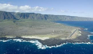 This Aug. 12, 2008, file photo, shows an aerial view of Kalaupapa Peninsula on Molokai, Hawaii. A handful of people with leprosy are still living full time on the isolated peninsula, but the National Park Service is already making plans to overhaul buildings and allow more visitors to the area when the last of the patients dies. (AP Photo/Hugh E. Gentry, File)