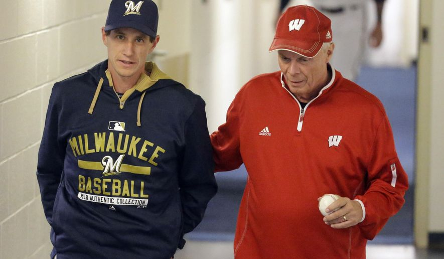 Milwaukee Brewers manager Craig Counsell talks to Wisconsin basketball coach Bo Ryan before a baseball game against the Los Angeles Dodgers Monday, May 4, 2015, in Milwaukee. (AP Photo/Morry Gash)