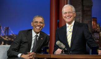 President Barack Obama with host David Letterman smile during a break at a taping of CBS The Late Show with David Letterman at the Ed Sullivan Theater in New York, Monday, May 4, 2015. (AP Photo/Pablo Martinez Monsivais)