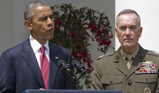 Marine Gen. Joseph Dunford, Jr. listens as President Barack Obama announces that he will nominate Dunford as the next chairman of the Joint Chiefs of Staff, Tuesday, May 5, 2015, in the Rose Garden of the White House in Washington. Obama chose the widely respected, combat-hardened commander who led the Afghanistan war coalition during a key transitional period during 2013-2014 to succeed Army Gen. Martin Dempsey. (AP Photo/Jacquelyn Martin)