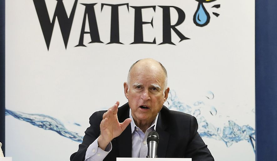 In this April 16, 2015, file photo, California Gov. Jerry Brown talks with reporters after a meeting about the drought at his Capitol office in Sacramento, Calif. (AP Photo/Rich Pedroncelli, File)