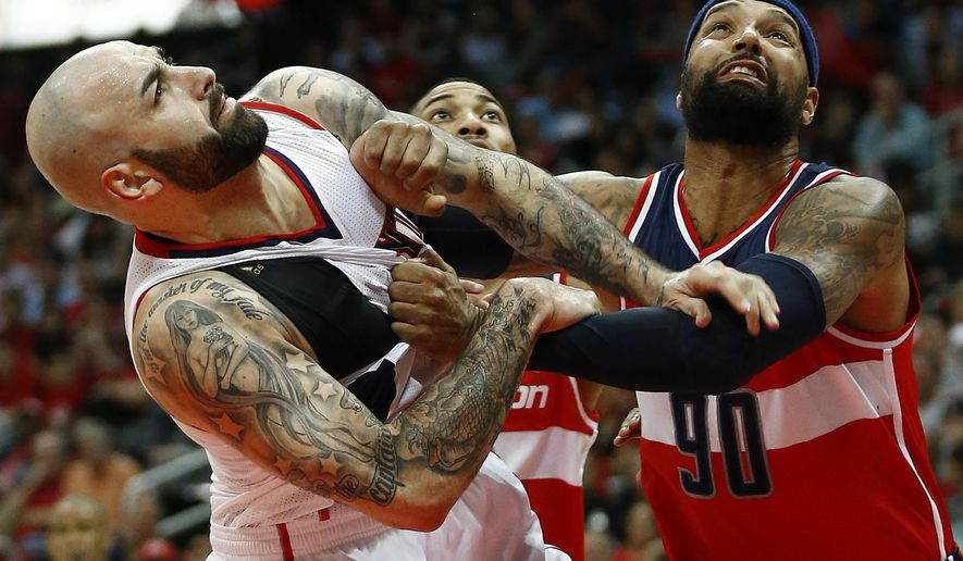 Atlanta Hawks forward Pero Antic, left, tangles up with Washington Wizards forward Drew Gooden (90) under the basket in the first half of game two of the second-round NBA playoff series basketball game  Tuesday, May 5, 2015, in Atlanta. (AP Photo/John Bazemore)