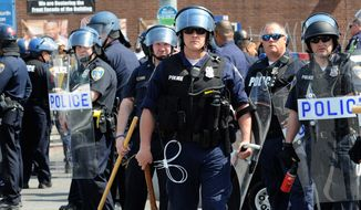 "Police in Baltimore and elsewhere have received an ""officer awareness bulletin"" from the Symbol Intelligence Group, which specializes in analyzing the dress, tattoos, symbols, codes and graffiti of potentially dangerous groups that show up at a growing number of anti-police demonstrations. (Associated Press)"