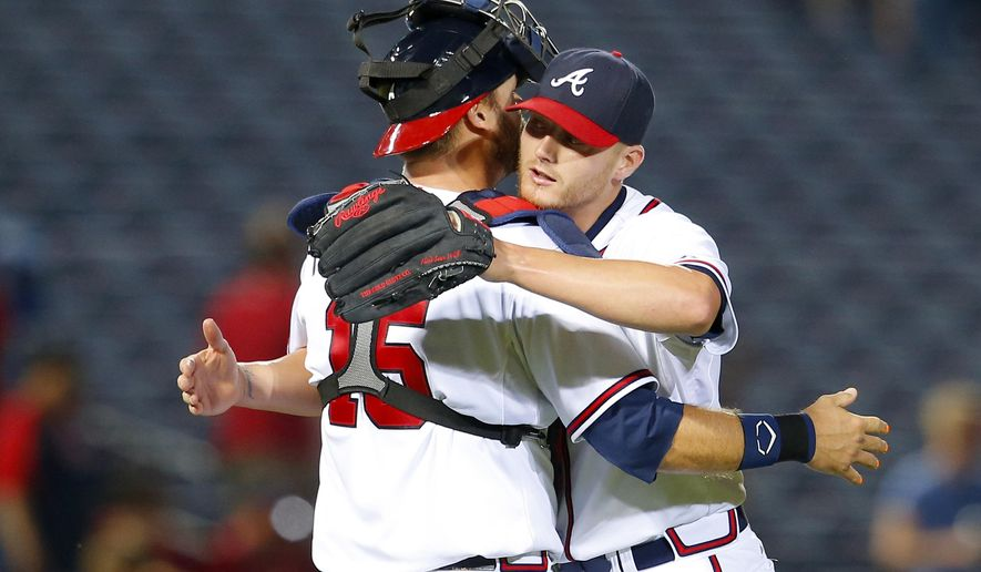 Atlanta Braves starting pitcher Shelby Miller, right, celebrates throwing a complete game with catcher A.J. Pierzynski (15) after a baseball game against the Philadelphia Phillies, Tuesday, May 5, 2015, in Atlanta. The Braves won the game 9-0. (AP Photo/Todd Kirkland)