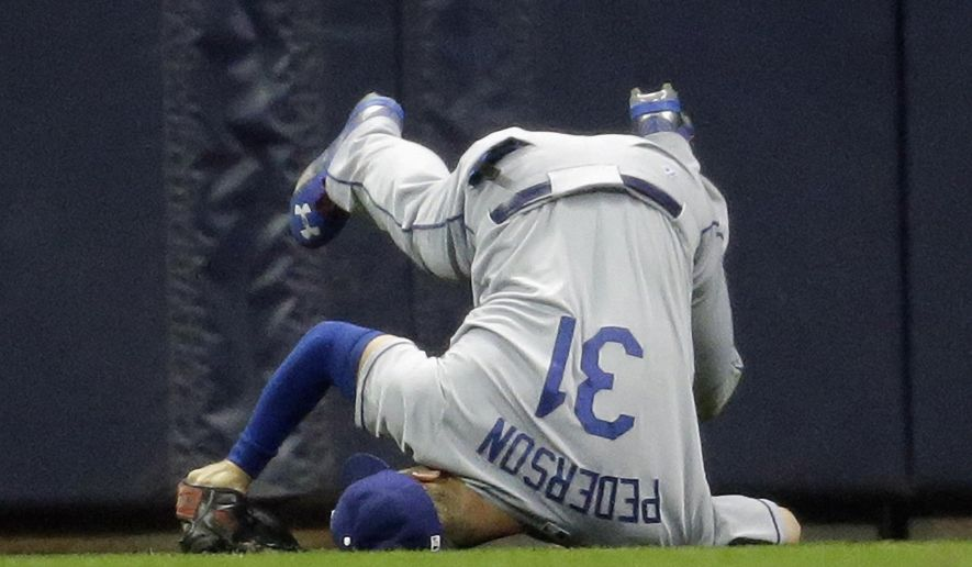 Los Angeles Dodgers' Joc Pederson can't catch an RBI double hit by Milwaukee Brewers' Jean Segura during the second inning of a baseball game Tuesday, May 5, 2015, in Milwaukee. (AP Photo/Morry Gash)