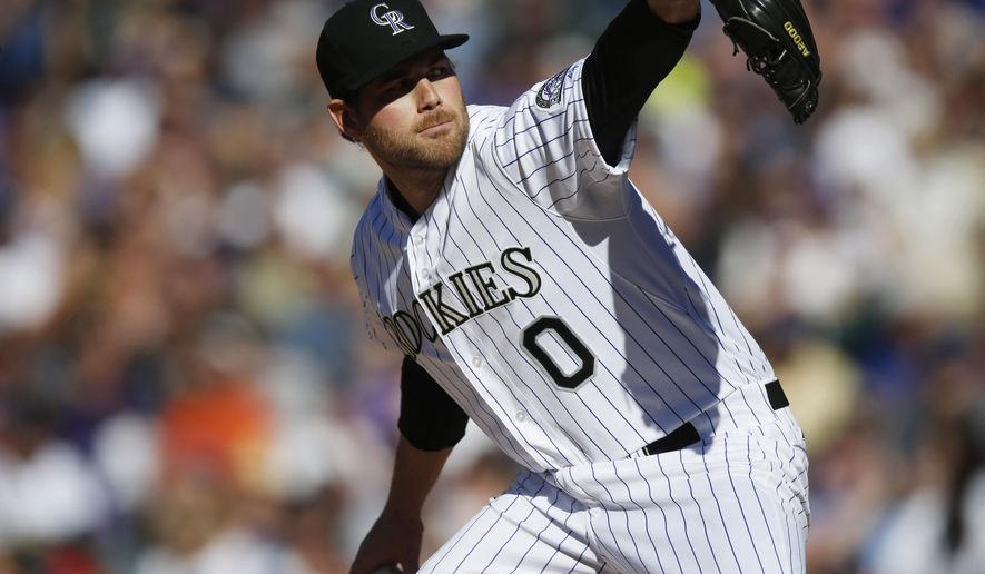 In this Sunday, April 12, 2015, photo, Colorado Rockies relief pitcher Adam Ottavino works against the Chicago Cubs in the eighth inning of a baseball game in Denver. Ottavino said Monday a recent MRI revealed a partial ulnar collateral ligament tear in his right elbow, which could mean he needs Tommy John surgery. (AP Photo/David Zalubowski)