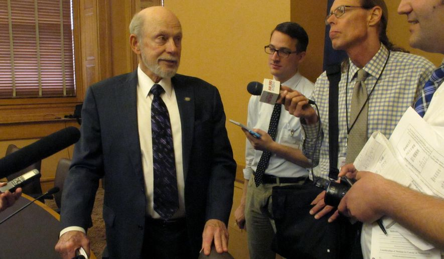Chairman Les Donovan speaks to reporters following a meeting of the Kansas Senate Assessment and Taxation Committee, Tuesday, May 5, 2015, at the Statehouse in Topeka, Kan. The committee is working on a plan for raising taxes to help balance the state budget. (AP Photo/John Hanna)