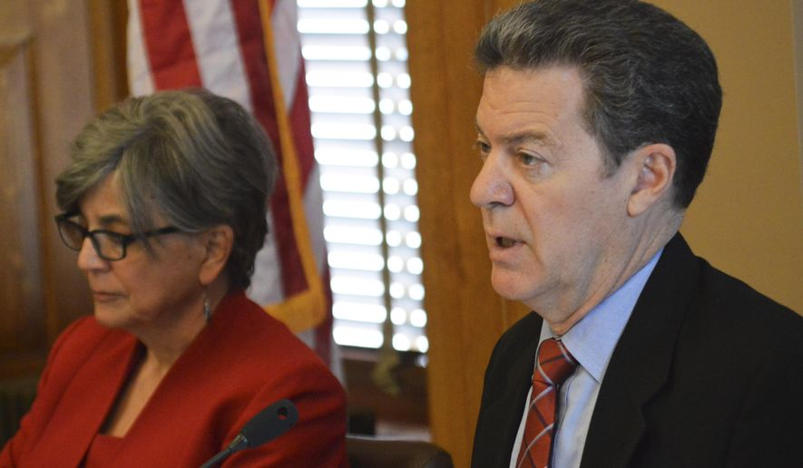 Kansas Gov. Sam Brownback, right, speaks during a meeting with legislative leaders, with state Senate President Susan Wagle to his left, Tuesday, May 5, 2015, at the Statehouse in Topeka, Kan. Brownback vetoed a bill imposing new regulations on ride-hailing companies like Uber and lawmakers, including Wagle, have voted to override it. (AP Photo/Nicholas Clayton)
