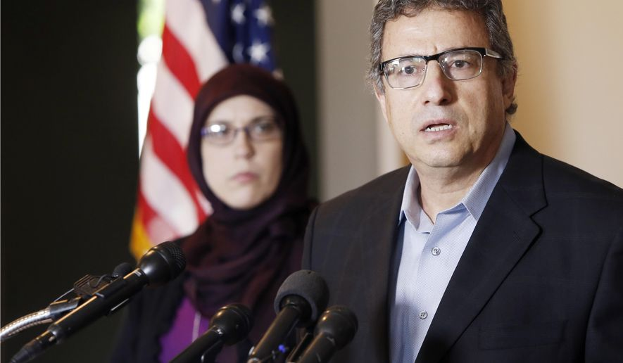 Muslim community leader Khalid Hamideh, right, and Alia Salem, Executive Director of Council on American-Islamic Relations, hold a news conference condemning the two gunmen who attempted to attack a contest for Muslim Prophet Muhammed cartoons, Monday, May 4, 2015, in Garland, Texas. A Garland police officer shot and killed both men. (AP Photo/Brandon Wade)