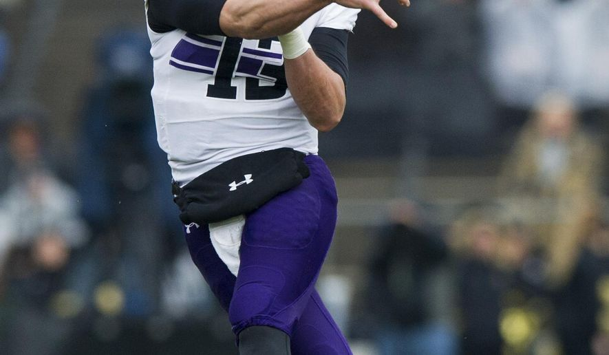 FILE - In this Nov. 22, 2014, file photo, Northwestern quarterback Trevor Siemian (13) lets go of a pass during the first half of an NCAA college football game against Purdue in West Lafayette, Ind. Brock Osweiler got married this offseason and this weekend, the Denver Broncos renewed their vows with Peyton Manning's backup. As expected, John Elway drafted a quarterback, something he's done three times since he signed Manning in 2012. But seventh-rounder Trevor Siemian of Northwestern is more of a threat to third-stringer Zac Dysert than he is to Osweiler.(AP Photo/Doug McSchooler, File)
