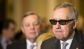 Senate Minority Leader Harry Reid of Nev. pauses while speaking to reporters on Capitol Hill in Washington, Tuesday, May 5, 2015, following a policy luncheon.  (AP Photo/Brett Carlsen)