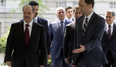 Iraqi Kurdistan Regional President Masoud Barzani, left, is escorted into West Wing of the White House in Washington, Tuesday, May 5, 2015, where he is scheduled to meet with Vice President Joe Biden. (AP Photo/Carolyn Kaster)