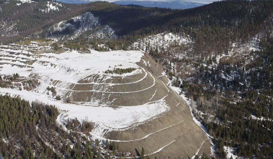 In this Feb. 17, 2010, file photo, the W.R. Grace mine is shown, outside of Libby, Mont. Libby, the town of 3,000 along the Kootenai River has emerged as the deadliest Superfund site in the nation's history. At least 400 people have been killed so far from W.R. Grace mine workers and family members who breathed in the dust they brought home in their clothes, to kids who played in waste tailings by the community baseball field. A cleanup proposal for a Montana town where thousands have been sickened by asbestos exposure calls for leaving some of the dangerous material in place rather than removing it. (AP Photo/Rick Bowmer, File)