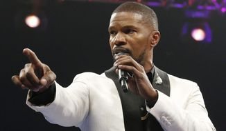 In this May 2, 2015, file photo, actor Jamie Foxx sings the national anthem before the start of the world welterweight championship bout between Floyd Mayweather Jr. and Manny Pacquiao in Las Vegas. (AP Photo/Isaac Brekken, File)