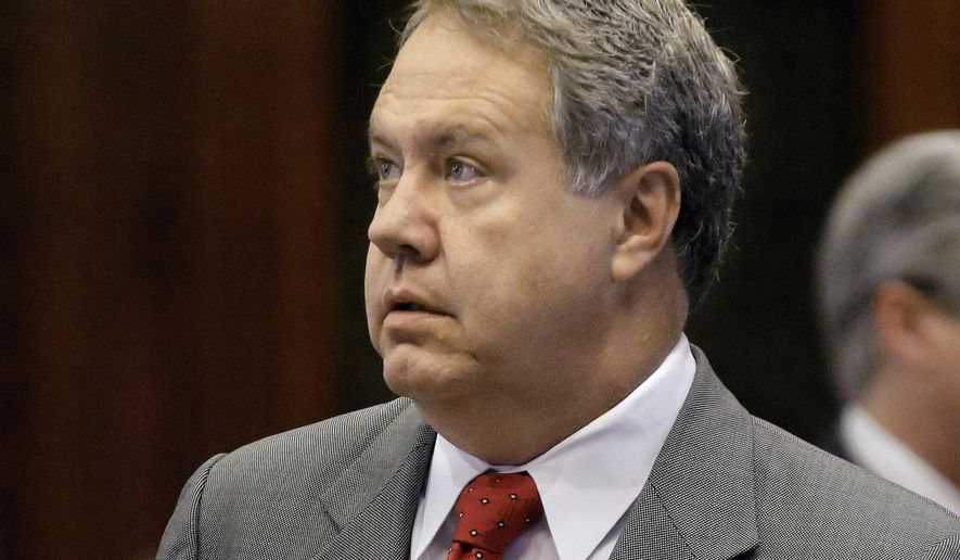 FILE - In this May 15, 2014 file photo, Illinois Rep. Jay Hoffman, D-Belleville, is seen on the House floor at the Capitol in Springfield, Ill. Business groups and injured employees weighed in Tuesday, May 5, 2015, as Illinois lawmakers began debating whether to overhaul the state's workers' compensation insurance program to make it more affordable for employers. (AP Photo/Seth Perlman,File)