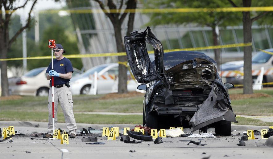 FBI crime scene investigators document evidence outside the Curtis Culwell Center, Monday, May 4, 2015, in Garland, Texas. Two men opened fire with assault weapons on police Sunday night who were guarding a contest for Muslim Prophet Muhammed cartoons. A police officer returned fire killing both men. (AP Photo/Brandon Wade)