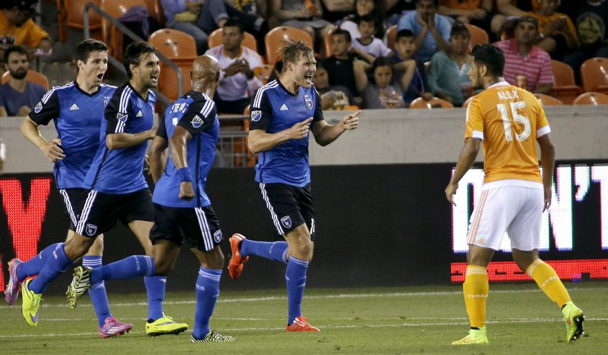 San Jose Earthquakes' Adam Jahn, center, celebrates after scoring a goal during the second half of an MLS soccer game against the Houston Dynamo Tuesday, May 5, 2015, in Houston. The Earthquakes won 1-0. (AP Photo/David J. Phillip)