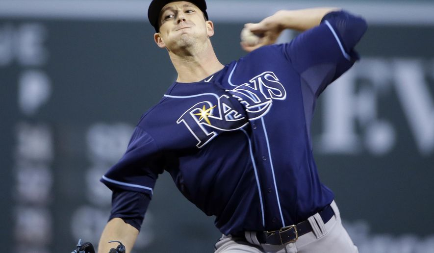 Tampa Bay Rays starting pitcher Drew Smyly delivers to the Boston Red Sox during the first inning of a baseball game at Fenway Park in Boston, Tuesday, May 5, 2015. (AP Photo/Elise Amendola)
