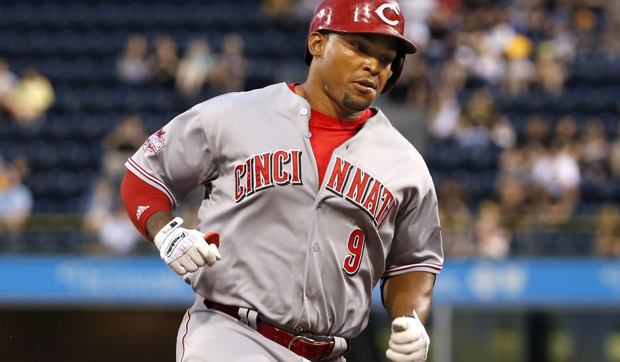 Cincinnati Reds' Marlon Byrd (9) rounds third after hitting a two-run-home run off Pittsburgh Pirates starting pitcher Jeff Locke in the second inning of a baseball game in Pittsburgh, Tuesday, May 5, 2015. (AP Photo/Gene J. Puskar)