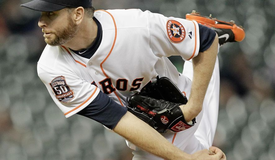 Houston Astros starting pitcher Scott Feldman (46) throws in the first inning against the Texas Rangers in a baseball game Tuesday May 5, 2015 in Houston. (AP Photo/Bob Levey)