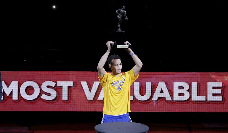 Golden State Warriors guard Stephen Curry acknowledges the crowd during a ceremony for winning the NBA's Most Valuable Player award before Game 2 in a second-round NBA playoff basketball series between the Warriors and the Memphis Grizzlies in Oakland, Calif., Tuesday, May 5, 2015. (AP Photo/Jeff Chiu)