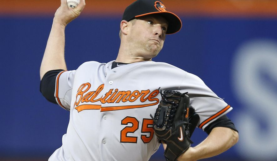 Baltimore Orioles starting pitcher Bud Norris delivers in the first inning of a baseball game against the New York Mets in New York, Tuesday, May 5, 2015. (AP Photo/Kathy Willens)
