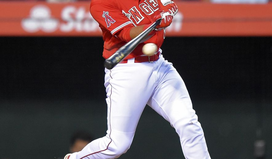 Los Angeles Angels' Carlos Perez connects for a single during the second inning of a baseball game against the Seattle Mariners, Tuesday, May 5, 2015, in Anaheim, Calif. (AP Photo/Mark J. Terrill)