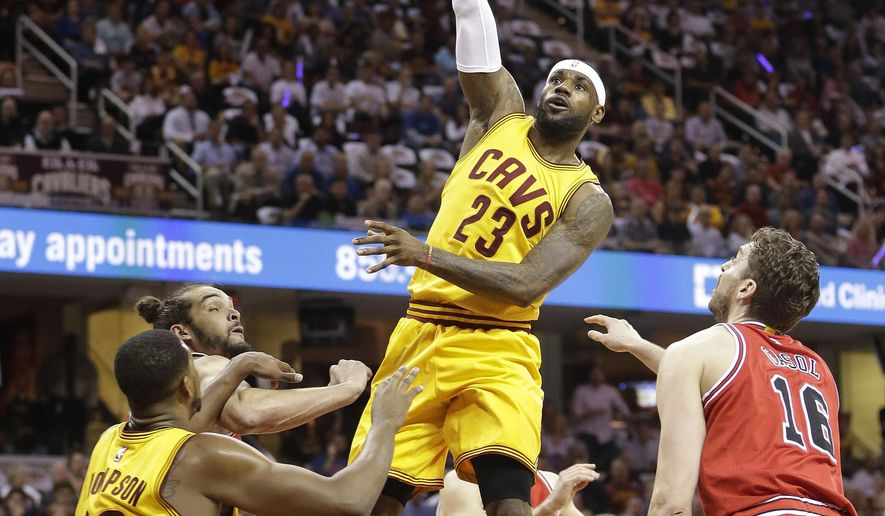 Cleveland Cavaliers forward LeBron James (23) shoots against the Chicago Bulls during the first half of Game 2 in a second-round NBA basketball playoff series Wednesday, May 6, 2015, in Cleveland. (AP Photo/Tony Dejak)