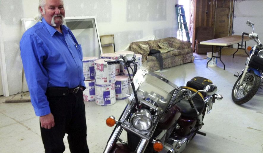In this photo taken April 29, 2015, Helaman Barlow poses besides motorcycles in his workshop in Colorado City, Ariz. Barlow, the former police chief in the polygamous community led by Warren Jeffs, says he took direction from sect leaders and ignored underage marriages. Barlow, 49, was put on administrative leave in April 2014 and fired several months later. He has now left the sect and in exchange for immunity, is working with state and federal officials who are investigating a group known as The Fundamentalist Church of Jesus Christ of Latter-Day Saints. (Nate Carlisle/The Salt Lake Tribune via AP) DESERET NEWS OUT; LOCAL TELEVISION OUT; MAGS OUT
