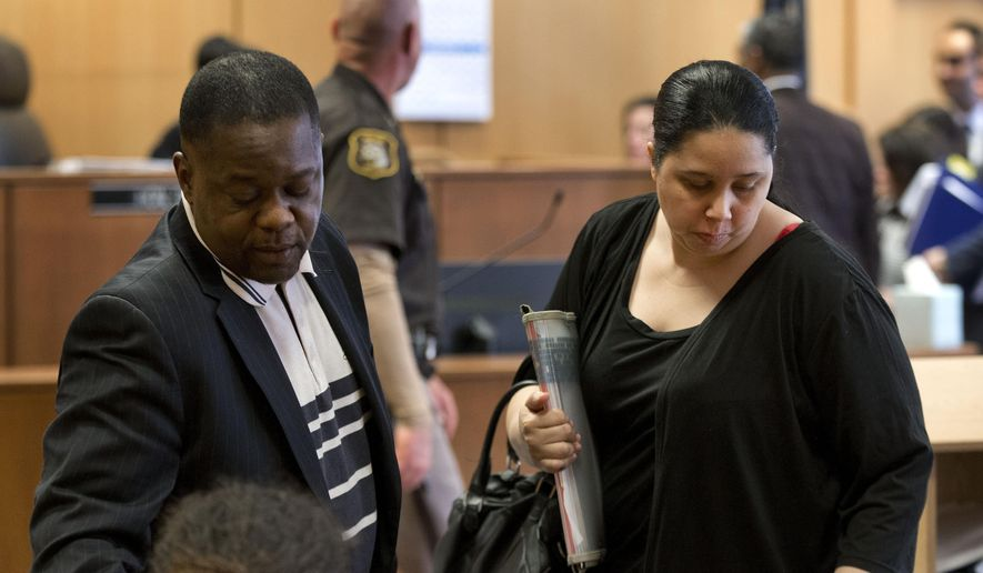 "FILE- In this April 14, 2015 file photo, Charlie Bothuell IV, left, and Monique Dillard-Bothuell appear in court in Detroit. Charlie Bothuell, a boy reported missing for 11 days before he was found in his Detroit basement testified Wednesday, May 6, 2015, that his stepmother ordered him down there and told him to ""shut up and be quiet"" while investigators scoured the neighborhood searching for him last June. (AP Photo/Paul Sancya, File)"