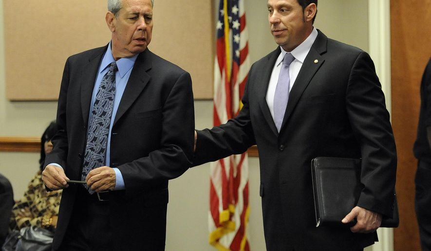 Former Inkster Police Officer William Melendez, right, walks with defense attorney David Lee into the courtroom of Judge Sabrina L. Johnson for a probable cause hearing on Wednesday, May 6, 2015 in Detroit.  Melendez is charged in the beating of a black motorist following a traffic stop in the Detroit suburb of Inkster in January. Footage from a police dashboard camera showed 57-year-old Floyd Dent being pulled from his car  and repeatedly punched in the head.  Melendez was fired last month and charged with assault. He denies any wrongdoing. A May 28 preliminary examination was set.  (Jose Juarez/Detroit News via AP)  DETROIT FREE PRESS OUT; HUFFINGTON POST OUT