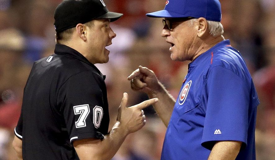 Chicago Cubs manager Joe Maddon, right, yells at home plate umpire D.J. Reyburn after being ejected by Reyburn during the sixth inning of a baseball game against the St. Louis Cardinals, Wednesday, May 6, 2015, in St. Louis. (AP Photo/Jeff Roberson)