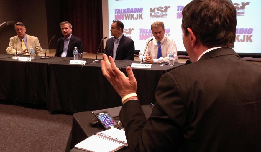 Kentucky Sports Radio host Matt Jones questions the four Republican candidates for governor during a live broadcast of his show in Louisville, Ky., Wednesday, May 6, 2015. The candidates, from left, are Will T. Scott, Hal Heiner, Matt Bevin and James Comer. (AP Photo/Adam Beam)