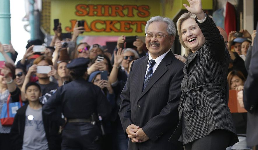 Democratic presidential candidate Hillary Rodham Clinton, right, waves next to San Francisco Mayor Ed Lee after visiting Red Blossom Tea Company in Chinatown in San Francisco, Wednesday, May 6, 2015. (AP Photo/Jeff Chiu)