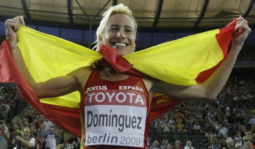 FILE - This is a Monday, Aug. 17, 2009, file photo of Spain's Marta Dominguez as she celebrates winning the gold medal in the Women's 3000m Steeplechase at the World Athletics Championships in Berlin.  Former world champion runner Marta Dominguez faces allegations of blood doping at a two-day hearing at sport's highest court. The Court of Arbitration for Sport said Tuesday May 5, 2015 it will hear appeals by the IAAF and World Anti-Doping Agency on June 24-25. (AP Photo/Matt Dunham, File)