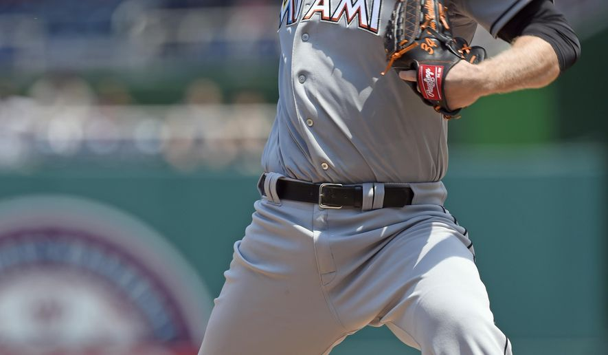 Miami Marlins starting pitcher Tom Koehler delivers a pitch against the Washington Nationals during the first inning of their baseball game at Nationals Park in Washington, Wednesday, May 6, 2015. (AP Photo/Susan Walsh)