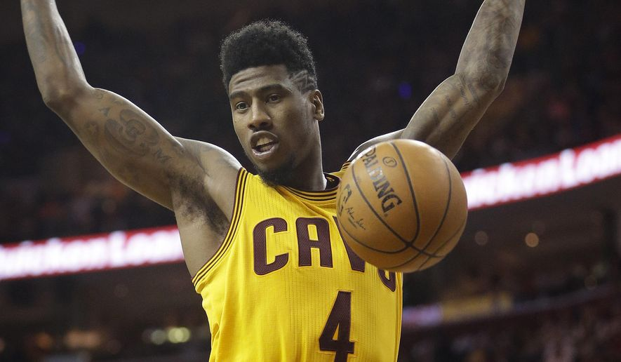 Cleveland Cavaliers guard Iman Shumpert (4) dunks the ball against the Chicago Bulls during the second half of Game 2 in a second-round NBA basketball playoff series Wednesday, May 6, 2015, in Cleveland. (AP Photo/Tony Dejak)