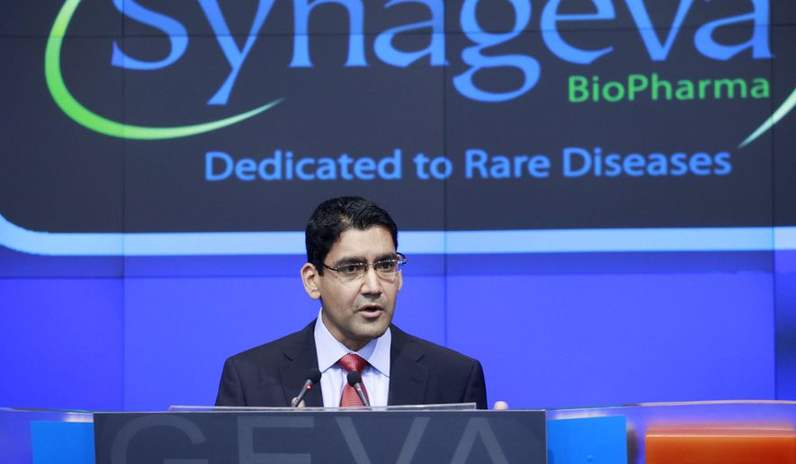 FILE - In this Nov. 3, 2011 file photo, Sanj Patel, President and CEO of Synageva BioPharma Corp., attends the opening bell ceremony at Nasdaq in New York. Alexion Pharmaceuticals on Wednesday, May 6, 2015 announced it is spending $8.4 billion to buy fellow rare disease treatment maker Synageva BioPharma, a company with no products on the market. (AP Photo/Mark Lennihan, File)