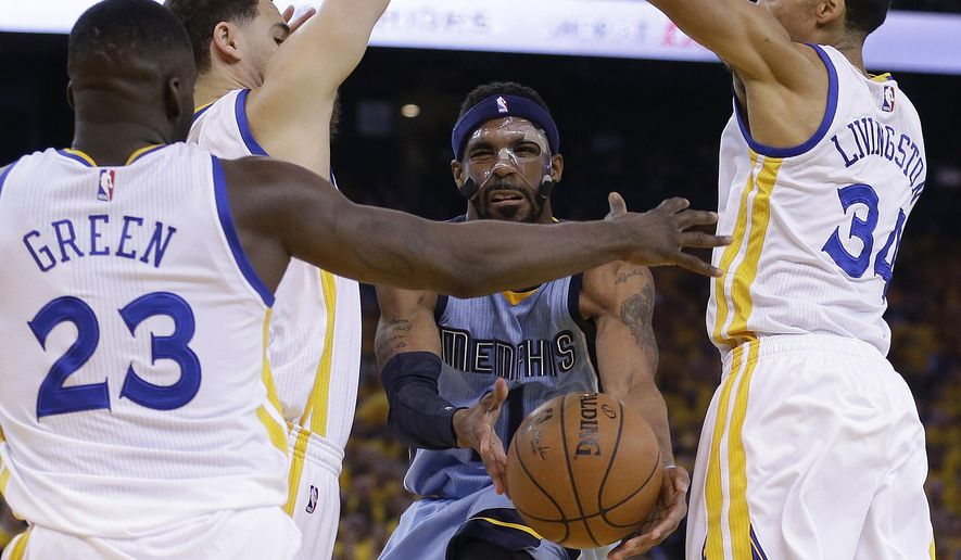 Memphis Grizzlies guard Courtney Lee, center, is defended by Golden State Warriors forward Draymond Green (23), guard Klay Thompson, second from left, and guard Shaun Livingston (34) during the first half of Game 2 in a second-round NBA playoff basketball series in Oakland, Calif., Tuesday, May 5, 2015. (AP Photo/Ben Margot)