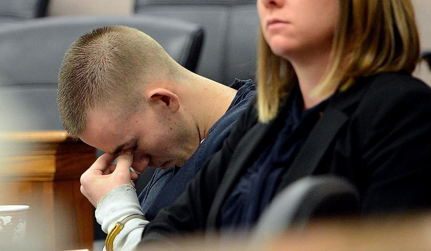 Austin Holford, one of the two teens who pleaded guilty to fatally beating a developmentally disabled man in Boulder to try to get his Xbox, reacts to statements made by the Tuneberg family in court Wednesday, May 6, 2015, Boulder, Colo. Holford was sentenced to 56 years in prison in Aaron Tuneberg's death. (Cliff Grassmick/The Daily Camera via AP) NO SALES; MANDATORY CREDIT