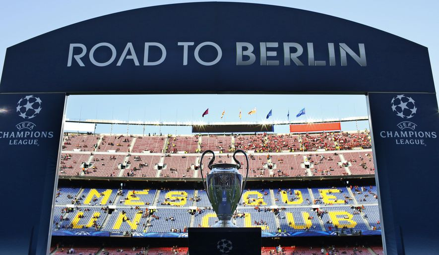 The Champions League trophy is on display prior to the Champions League semifinal first leg soccer match between Barcelona and Bayern Munich at the Camp Nou stadium in Barcelona, Spain, Wednesday, May 6, 2015.  (AP Photo/Manu Fernandez)