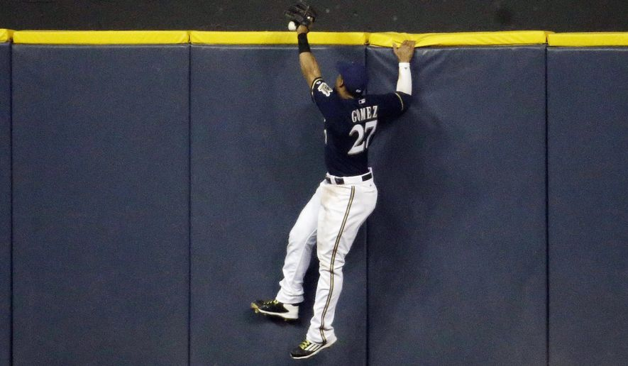 Milwaukee Brewers' Carlos Gomez can't catch a home run hit by Los Angeles Dodgers' Joc Pederson during the fifth inning of a baseball game Wednesday, May 6, 2015, in Milwaukee. (AP Photo/Morry Gash)